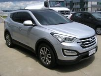 Hyundai Santa Fe 3.3L V6 4x4 (Aut) 7L 2015}