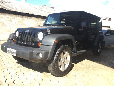 Jeep Wrangler 3.6 4WD Unlimited Sport (Aut) 2012}